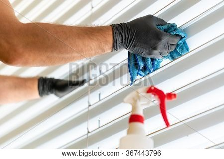 Caucasian Man Cleaning Professionally Cleaning Window Blinds With A Micro Fiber Cloth And Cleaning D