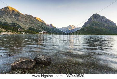 Beautiful Landscape At Swiftcurrent Lake  When Sunrise In Many Glacier Area ,montana\'s Glacier Nati