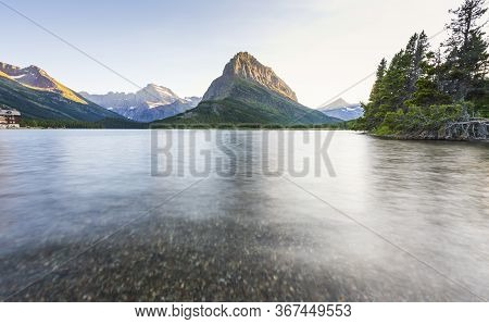 Beautiful Landscape At Swiftcurrent Lake  When Sunrise In Many Glacier Area ,montana\\\'s Glacier Na