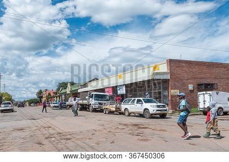 Clocolan, South Africa - March 20, 2020: A Street Scene, With Businesses, People And Vehicles, In Cl