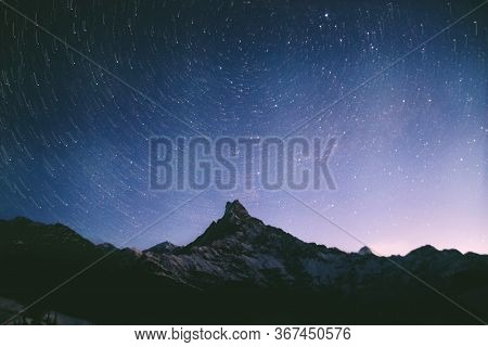 Snow Covered Mountains With Rotating Star Sky