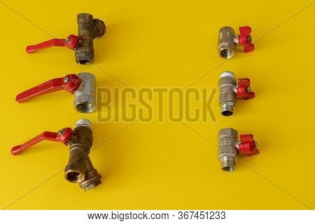 Safety Valves With Red Handles. Safety Valves On A Colored Background