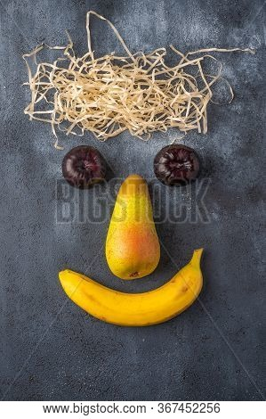 Concept Face Of Fruit And Straw. Vertical Orientation. Top View