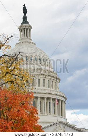 U.S. Capitol building in autumn foliage - Washington D.C. United States of America