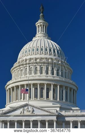 U.S. Capitol Dome  and waving US National flag close-up - Washington D.C. United States of America