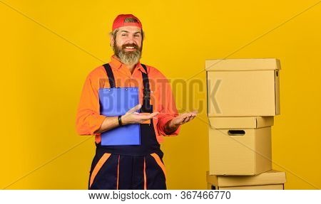 Bearded Loader In Uniform. Insurance Agent. Moving Day. Renovation Preparation. Unpacking Moving Box