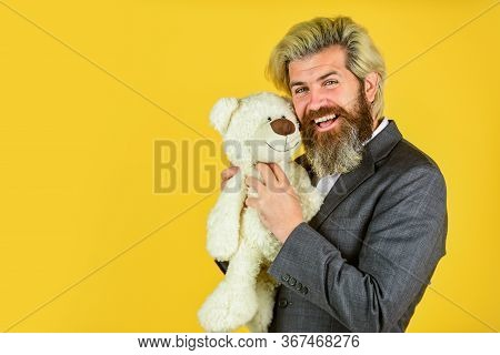 Brutal Bearded Man Ready For Romantic Date. Valentines Day Gift. Man In Jacket Hold Teddy Bear. Biza