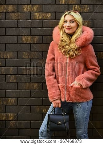 Natural Wool Sheepskin Coat. Fur On Hood. Stay Warm And Fashionable. Glamorous Lady. Woman Wear Furr
