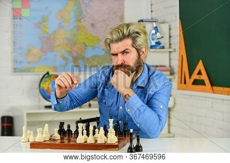 Chess Federation. Schoolboard Fun. Teacher Make Training Lesson. Education Concept. Mature Man Playi