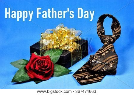 Happy Father's Day-a Conceptual Inscription Of The Greeting Text. Gift, Red Rose, Tie. The Annual Ho