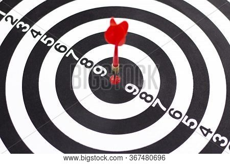 Dartboard With Hit Bullseye On White Background, Closeup. Bullseye Is A Business Target. Target Conc