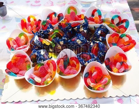 Selection Of Colorful Candies And Jellies In A Children's Birthday Outdoors Party