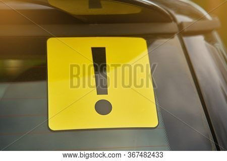 Attention Sign On Car Glass. Inexperienced Driver Concept.