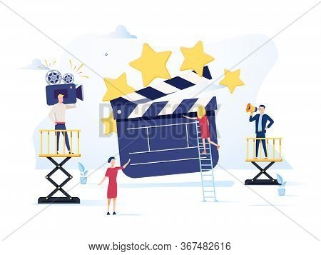 Movie Making Process Concept. Operator Using Camera And Staff With Professional Equipment Recording
