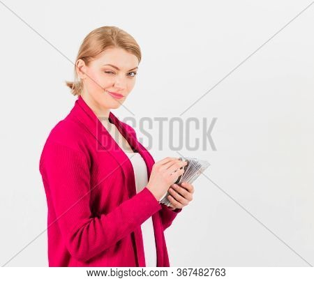 Woman With Blinking Face Counting Money, Isolated On White Background.