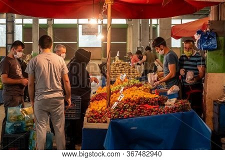 Eskisehir, Turkey - May 21, 2020: People With Medical Masks At Traditional Turkish Grocery Bazaar Du