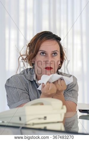 Portrait Of Office Worker Woman Vomits Letter, Document. Woman Reads Negative News In A Letter. Shoc