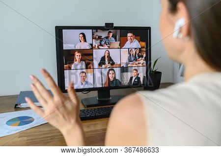 Morning Meeting Online. A Young Woman Is Using App On Pc For Connection With Colleagues, Employees.