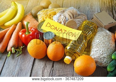Food Donation Background With Various Products: Pasta, Oatmeal, Vegetables, Fruits, Oils, Cookises A