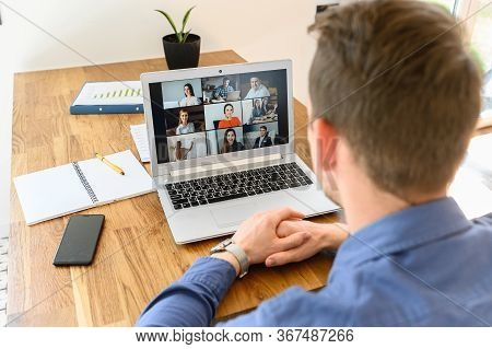 Webinars, Online Conference, Video Meeting. A Businessman Is Using App On Laptop For Video Connect W