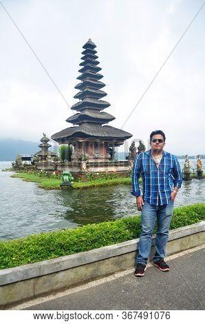Travelers Thai Men People Travel Visit And Respect Praying Of Pura Ulun Danu Bratan Or Pura Bratan H
