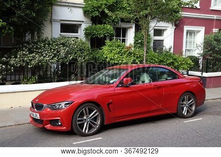 London, Uk - July 13, 2019: Red Flashy Bmw M2 Sports Car Parked In London. There Are 37.7 Million Ve