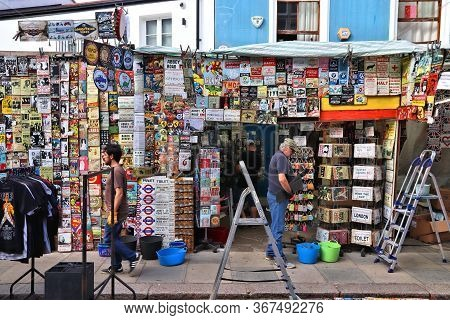 London, Uk - July 13, 2019: People Visit Portobello Road Market In Notting Hill District Of London.