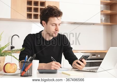 Man Using Laptop At Home. Job Search Or Remote Work Concept