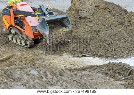 Excavator Digging Soil During Pushes A Ground Excavation Earthmoving