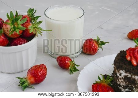 Tasty Fresh Milk On A White Wooden Background. Homemade Cookies And A Glass Of Milk. Strawberry. Cop