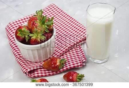Tasty Fresh Milk On A White Wooden Background. Strawberries And Glass Of Milk. Strawberry. Copy Spac