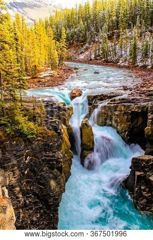 Large Boulder Stands In The Way Of Water Rushing Over The Sumwapta Falls. Yoho National Park, Albert