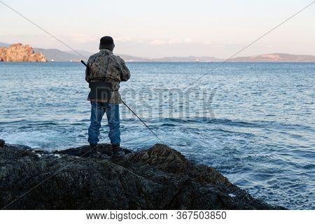 Sea fishing fisherman in the evening