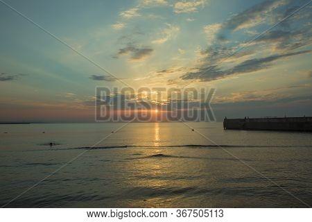 The Sunset, The Sea And The Clouds. Caspian Sea. Azerbaijan Baku Beautiful Sunset In Yellow As Backg