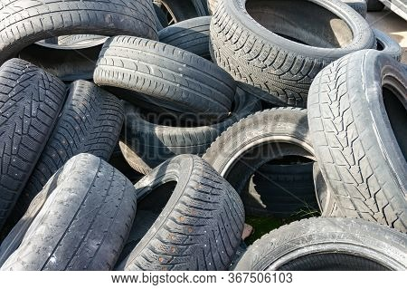 A Pile Of Old Used Rubber Car Protector Tires At Auto Service Or Dump With Rubbish And Waste Ready F
