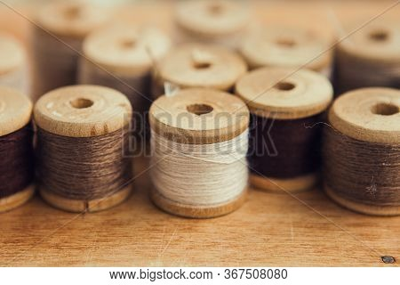 Set Of Thread On Wooden Background, Close Up