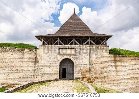 Gate Of Khotyn Fortress Castle In Ukraine On A Background Of Dark Clouds On A Cloudy Windy Day In Su