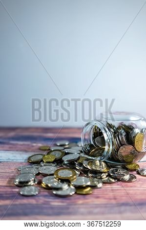 Coins And Jar Investment, Salary, Loan, Investment Concept. Save Money Concept. Singapore Dollar Coi
