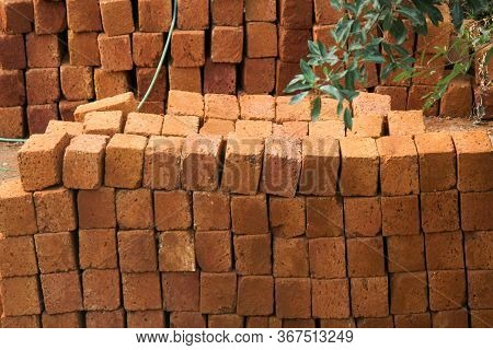 Pile Of Red Laterite Rectangular Stones Used For The Constructions Of Buildings And Walls In India,