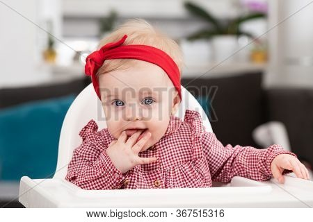 Portrait Of Baby Child In Chair