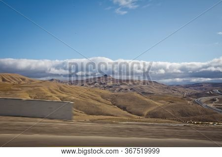 Desert-mountainous Terrain . Blue Sky With Many White Clouds. Desert And Mountain Landscape With Aze