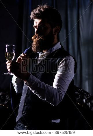 Handsome Young Well-dressed Man In Luxury House Interior With Glass Of White Wine