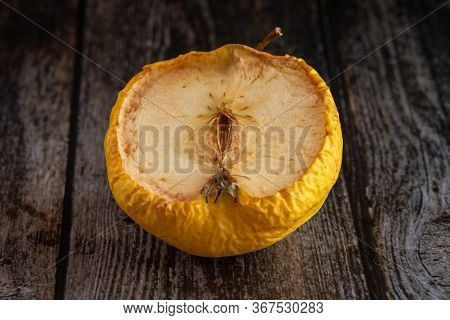 Yellow Wilted Rotten Half Apple Details On A Wooden Surface