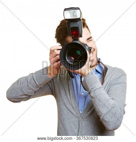Professional photographer with a digital camera and a system flash