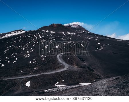 Etna Volcano And The Road To It Along The Mountainside.