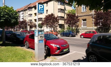 Gyor Hungary 05 21 2020: A Green License Plate Opel Ampera Electric Car Is Parked Next To A Parking