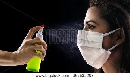 Portrait of young woman wearing medical mask