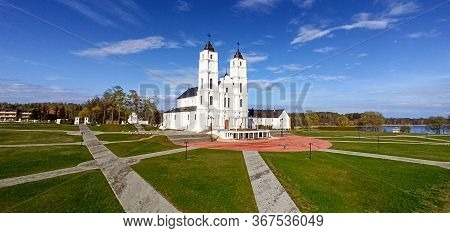 Majestic Aglona Cathedral In Latvia. White Chatolic Church Basilica. Sunny Spring Day Blue Sky And W