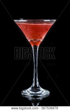 Closeup Glass Of Cosmopolitan   On Black Background