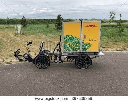 Almere, The Netherlands - May 22, 2020: Dhl Inner-city Electric Delivery Cargo Bike Parking On A Pub